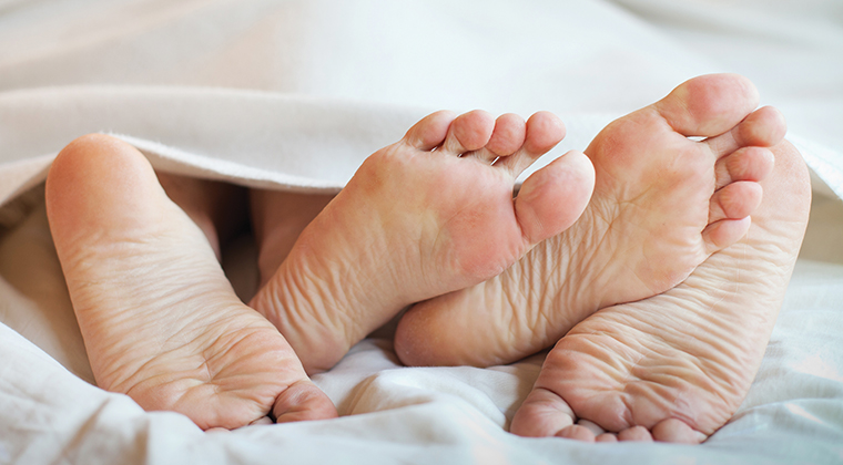 couple in bed feet