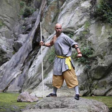 monk standing on a rock